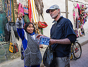 Shopping for fabric goods in Huaraz, in the Santa Valley (Callejon de Huaylas), Ancash Region, Peru, Andes Mountains, South America. For licensing options, please inquire.