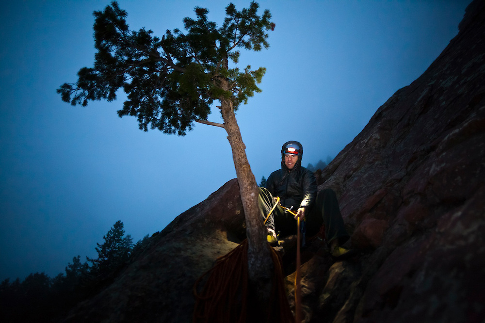 Obadiah Reid belays the photographer to a tree on a climb of the First Flatiron (Direct East Face, 5.6) above Boulder, Colorado.