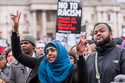 © Licensed to London News Pictures. 21/03/2015. Trafalgar Square, London UK. A woman dancing to the music is part of the large crowds carrying banners and placards assembled in Trafalgar Square for the Stand Up to Racism and Fascism rally. Photo credit : Stephen Chung/LNP