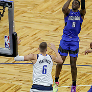 ORLANDO, FL - MARCH 01: Dwayne Bacon #8 of the Orlando Magic attempts a shot over Kristaps Porzingis #6 of the Dallas Mavericks during the first half at Amway Center on March 1, 2021 in Orlando, Florida. NOTE TO USER: User expressly acknowledges and agrees that, by downloading and or using this photograph, User is consenting to the terms and conditions of the Getty Images License Agreement. (Photo by Alex Menendez/Getty Images)*** Local Caption *** Dwayne Bacon; Kristaps Porzingis
