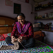 Gudiya Khan sits in her bedroom approximately 10km from Ranikhet, India, knitting a cushion cover on Dec. 4, 2018.