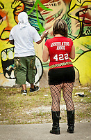 Participant looking at graffiti artist during the Fort Lauderdale 2011 Graffiti Festival. Editorial Use Only.
