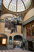 In the marbled atrium where the tickets can be bought for the cinema, hangs David Cerny's sculpture called Kun, an equestrian sculpture of  St Wenceslas in Wenceslas Square in Lucerna Gallery, on 19th March, 2018, in Prague, the Czech Republic. Lucerna is the most elegant of Nove Mesto's many shopping arcades runs through the art-nouveau Lucerna Palace 1920, between Stepanska and Vodickova streets. The complex was designed by Vaclav Havel grandfather of the former president, and is still partially owned by the family. It includes theatres, a cinema, shops, a rock club and several cafes and restaurants. Here St Wenceslas sits astride a horse that is decidedly dead; it's safe to assume this is a reference to Vaclav Klaus, president of the Czech Republic from 2003 to 2013.