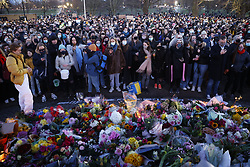 © Licensed to London News Pictures. 13/03/2021. London, UK. People gather at the bandstand on Clapham Common during a vigil for murder victim Sarah Everard. Metropiltan Police officer Wayne Couzens has been charged with the kidnap and murder of Sarah Everard, who went missing as she walked across Clapham Common in south London. The 33-year-old's body was found in Kent just over a week later. Photo credit: Peter Macdiarmid/LNP
