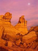 Moon rising over Chinle Formation badlands at dusk, Blue Mesa, Petrified Forest National Park, Arizona.
