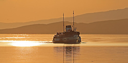 Waverley is one of the world's greatest historic ships – the last sea-going paddle steamer in the world. Seen here returning to Oban as the sunsets behind her after a days cruise to Armadale. (c) Stephen Lawson   Edinburgh Elite media