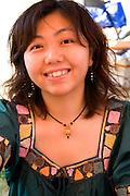 Happy woman at the Japan America Society of Minnesota booth. Dragon Festival Lake Phalen Park St Paul Minnesota USA