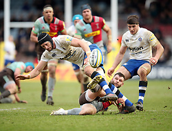 Bath's Luke Charteris is tackled by Harlequins' Dave Lewis during the Aviva Premiership match at Twickenham Stoop, London.