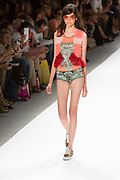 Print swimsuit with fuzzy vest. By Custo Barcelona at the Spring 2013 Fashion Week show in New York.