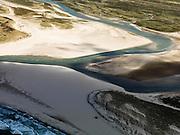 Nederland, Noord-Holland, Texel, 16-04-2012; Ingang van De Slufter, gezien vanaf de Noordzee.Het natuurgebied, een duinvalllei met kreken, is ontstaan doordat de duinen in het verleden doorgebroken zijn. De Sluftervallei staat in open verbinding met de Noordzee en wordt beïnvloed door eb en vloed..Entrance to natural area The Slufter, beach and dunes of the isle of Texel. luchtfoto (toeslag), aerial photo (additional fee required);.copyright foto/photo Siebe Swart
