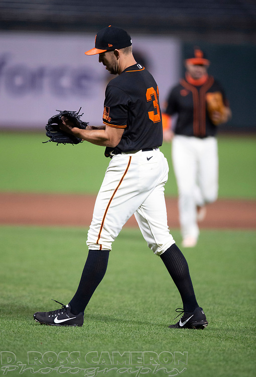 Aug 22, 2020; San Francisco, California, USA; San Francisco Giants starting pitcher Tyler Anderson (31) pounds his glove after getting the final out of his complete game victory over the Arizona Diamondbacks during the ninth inning of a baseball game at Oracle Park. Mandatory Credit: D. Ross Cameron-USA TODAY Sports