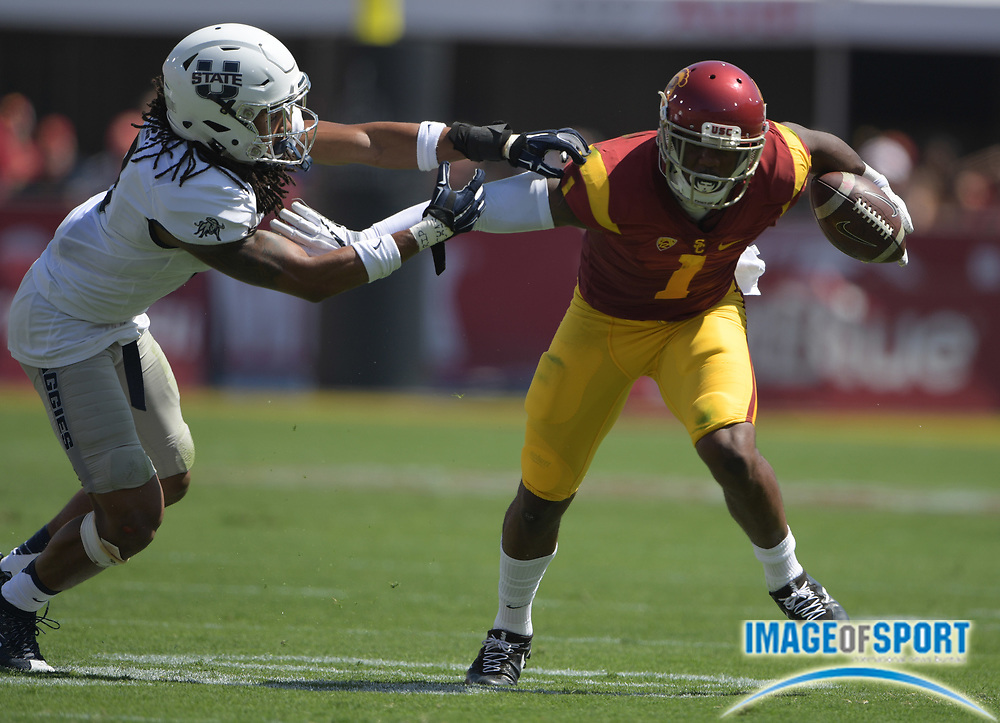 Sep 10, 2016; Los Angeles, CA, USA; USC Trojans wide receiver Darreus Rogers (1) is defended by  Utah State Aggies cornerback Wesley Bailey (8) during a NCAA football game at Los Angeles Memorial Coliseum.