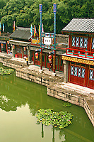 Lakeside buildings at the Summer Palace in Beijing, China.  Gate to the Summer Palace, one of the Dowager Empress' fantasies built around Kunming Lake outside of Beijing in an effort to keep the Empress cool during summer months.