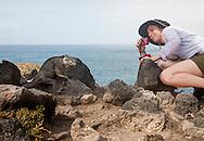 Visitor photographing Land Iguana, Galapagos