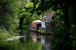 UNITED KINGDOM HAMPSHIRE 17JUN09 - A pub stands next to the chalkstream river Itchen at Man's Bridge near Swaythling in Hampshire, southern England...The river has a total length of 28 miles, and is noted as one of England's - if not one of the World's - premier chalk streams. It is designated as a Site of Special Scientific Interest and is noted for its high quality habitats, supporting a range of protected species...jre/Photo by Jiri Rezac / WWF UK..© Jiri Rezac 2009