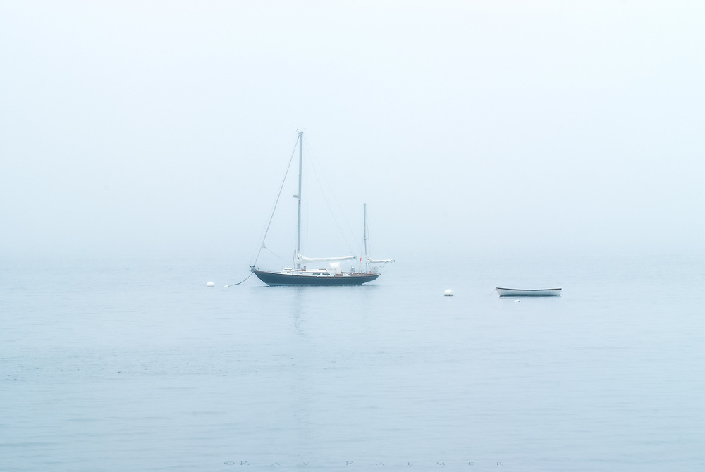 Northeast Harbor, Maine<br /> It was miserable weather in June of the year I made this image.  The fog and rain was nice the first couple of days, but then became a drudgery of being cooped up in the downpours, and dulled by limited vistas in between.  It went on for a week. On this day I roamed in Acadia rather aimlessly, ending up in Northeast Harbor.  Almost into concealment, this ketch sat with it's companion, no doubt unable or unwilling to go out into the cloud, and sat suspended in the calm harbor, anchored for the day.