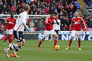 Gonzalo Jara of Nottingham Forest © makes a break. Skybet championship match, Bolton Wanderers v Nottingham Forest at the Reebok Stadium in Bolton, England on Saturday 11th Jan 2014.<br /> pic by David Richards, Andrew Orchard sports photography.