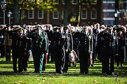 Members of the armed forces salute during a Remembrance Sunday service in Queen's Square, Bristol, held in tribute for members of the armed forces who have died in major conflicts.