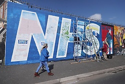 Work continues on a huge NHS Mural on Belfast's Falls Road by well-known artists Lyonsi and Micky Doc.