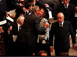 Funeral of Diana, Princess of Wales, 6th September 1997 Express picture by John Downing inside Westminster Abbey. A fellow mourner embraces Raine Spencer as Mohamed Al Fayed passes.