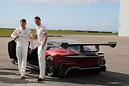 Glamorgan cricket players Michael Hogan ® and Aneurin Donald (l) check out an Aston Martin .Glamorgan CC media day and photocall at Aston Martin, St Athan, near Cardiff , South Wales on Thursday 6th April 2017.<br /> pic by Andrew Orchard, Andrew Orchard sports photography.