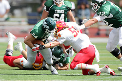 19 September 2015:  Austin Harrell meets Jonathan Masterson during an NCAA division 3 football game between the Simpson College Storm and the Illinois Wesleyan Titans in Tucci Stadium on Wilder Field, Bloomington IL