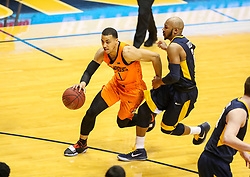 Feb 10, 2018; Morgantown, WV, USA; Oklahoma State Cowboys guard Kendall Smith (1) dribbles past West Virginia Mountaineers guard Jevon Carter (2) during the first half at WVU Coliseum. Mandatory Credit: Ben Queen-USA TODAY Sports