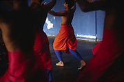 Boys practice at dawn at a dance class at the Kerala Kalamandalam, Kerala, India<br /> The Kalamandalam was founded in 1930 to preserve the cultural traditions of Kathakali, the stylised dance drama of Kerala. Kathakali is the classical dance-drama of Kerala, South India, which dates from the 17th century and is rooted in Hindu mythology. Kathakali is a unique combination of literature, music, painting, acting and dance performed by actors wearing extensive make up and elaborate costume who perform plays which retell in dance form stories from the Hindu epics.