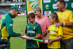 Faf du Plessis signs the bat for the momentum family of the day during the 2nd ODI match between South Africa and Australia held at The Wanderers Stadium in Johannesburg, Gauteng, South Africa on the 2nd October  2016<br /> <br /> Photo by Dominic Barnardt/ RealTime Images