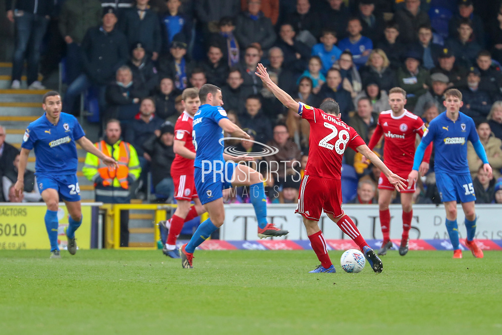 Accrington Stanley defender Seamus Conneely (28) with a shot on goal during the EFL Sky Bet League 1 match between AFC Wimbledon and Accrington Stanley at the Cherry Red Records Stadium, Kingston, England on 6 April 2019.
