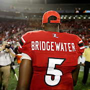 Louisville Cardinals quarterback Teddy Bridgewater (5) heads off the field of play after the NCAA Football Russell Athletic Bowl football game between the Louisville Cardinals and the Miami Hurricanes, at the Florida Citrus Bowl on Saturday, December 28, 2013 in Orlando, Florida. Louisville won the game by a score of 36-9. (AP Photo/Alex Menendez)