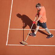 PARIS, FRANCE June 11.  A member of the ground staff cleans the lines between sets on Court Philippe-Chatrier during the semi finals of the singles competition at the 2021 French Open Tennis Tournament at Roland Garros on June 11th 2021 in Paris, France. (Photo by Tim Clayton/Corbis via Getty Images)