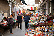 Chinese stall holders selling souvenirs at market in Moslem district of Xian, China