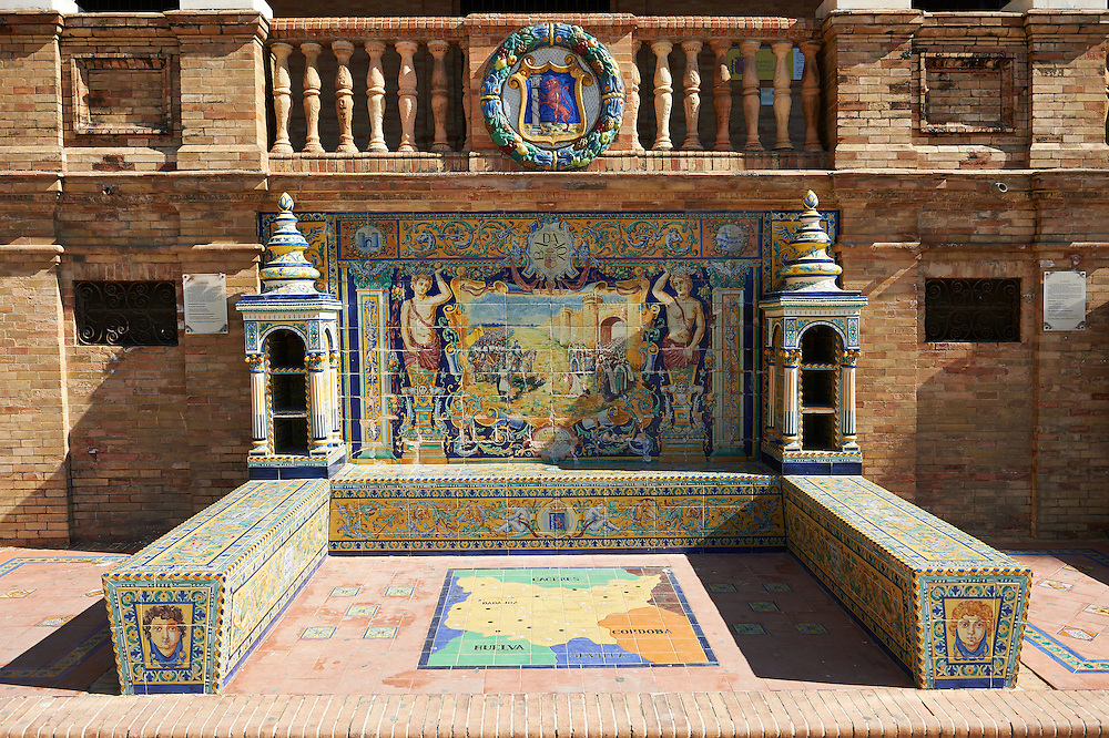 The Badajoz alcove along the walls of the Plaza de Espana in Seville built in 1928 for the Ibero-American Exposition of 1929, Seville Spain . The Royal Alcázars of Seville (al-Qasr al-Muriq ) or Alcázar of Seville, is a royal palace in Seville, Spain. It was built by Castilian Christians on the site of an Abbadid Muslim alcazar, or residential fortress.The fortress was destroyed after the Christian conquest of Seville The palace is a preeminent example of Mudéjar architecture in the Iberian Peninsula but features Gothic, Renaissance and Romanesque design elements from previous stages of construction. The upper storeys of the Alcázar are still occupied by the royal family when they are in Seville. <br /> <br /> Visit our SPAIN HISTORIC PLACES PHOTO COLLECTIONS for more photos to download or buy as wall art prints https://funkystock.photoshelter.com/gallery-collection/Pictures-Images-of-Spain-Spanish-Historical-Archaeology-Sites-Museum-Antiquities/C0000EUVhLC3Nbgw <br /> .<br /> Visit our MEDIEVAL PHOTO COLLECTIONS for more   photos  to download or buy as prints https://funkystock.photoshelter.com/gallery-collection/Medieval-Middle-Ages-Historic-Places-Arcaeological-Sites-Pictures-Images-of/C0000B5ZA54_WD0s