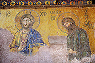 Byzantine Deësis ( Entreaty) mosaic , 1261, in which John The Baptist,  both shown in three-quarters profile, are imploring the intercession of Christ Pantocrator for humanity on Judgment Day.   Hagia Sophia, Istanbul, Turkey .<br /> <br /> If you prefer to buy from our ALAMY PHOTO LIBRARY  Collection visit : https://www.alamy.com/portfolio/paul-williams-funkystock/istanbul.html<br /> <br /> Visit our TURKEY PHOTO COLLECTIONS for more photos to download or buy as wall art prints https://funkystock.photoshelter.com/gallery-collection/3f-Pictures-of-Turkey-Turkey-Photos-Images-Fotos/C0000U.hJWkZxAbg