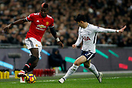 Paul Pogba of Manchester United (L) in action with Son Heung-min of Tottenham Hotspur (R). Premier league match, Tottenham Hotspur v Manchester Utd at Wembley Stadium in London on Wednesday 31st January 2018.<br /> pic by Steffan Bowen, Andrew Orchard sports photography.