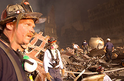 April 19, 2014 - New York, NY, United States of America - Urban Search and Rescue workers continue the recovery of victims amongst the wreckage of the World Trade Center in the aftermath of a massive terrorist attack which destroyed the twin towers killing 2,606 people September 19, 2001 in New York, NY. (Credit Image: © Andrea Booher/Planet Pix via ZUMA Wire)