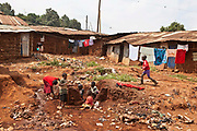 Children playing on a small section of spare land deep inside Kibera Slum, Nairobi, Kenya. Kibera is the largest slum in Nairobi and the second largest in Africa.