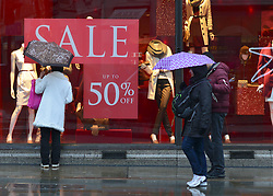 © Licensed to London News Pictures. 20/12/2012. London, UK Shoppers on Regent Street in Central London today 20 December 2012. Shops have started their traditional Christmas Sales as the latest retail sales figures are revealed, shoppers are urged to use smaller shops if they want to keep them alive. Fears that consumers are reining in their spending ahead of Christmas were fuelled after the latest retail figures showed a 0.1% rise in retail sales in November. Photo credit : Stephen Simpson/LNP