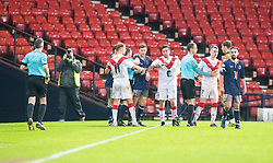 Ref Graham Beaton comes between Airdrie and Queen's Park players at the end. Queen's Park 2 v 1 Airdrie, Scottish Football League Division One game played 7/1/2017 at Hampden.
