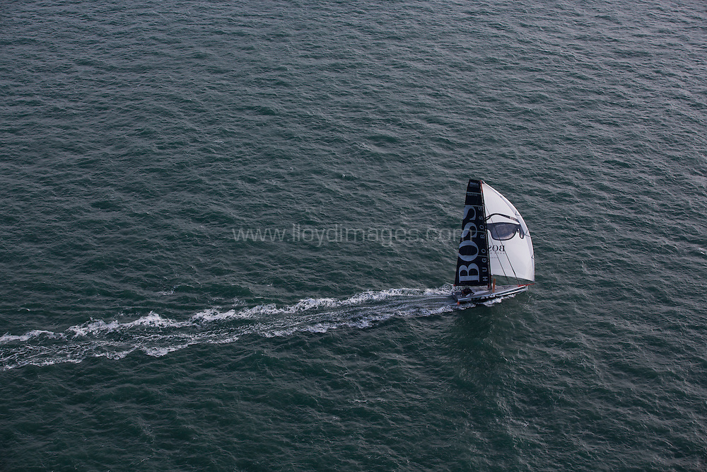 Pictures of the Hugo Boss IMOCA Open 60. Skippered by Alex Thomson, shown here on route home from the Vendee Globe 2013. A solo non stop around the world yacht race. ...Please credit: Lloyd Images