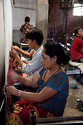 Ashal Carpet Factory does not employ children and is a licensee of the GoodWeave Foundation and their carpets carry the GWF label. It is a category C however and GWF inspectors come by regularly to check for child workers. Some women have no other alternative than to bring their children to work which is something GWF try to address by setting up child crea centres but they they cannot reach all children this way. The Good Weave Foundation is a charity set up in partnership with the Nepalese carpet industry. The aim is to eliminate child labor in all carpet factories in Nepal. Factories which do not employ children can sign up with the charity and become a licensee to the GWF brand and label their carpets with the GWF label which promises any buyers abroad that no children were involved in making the carpets.