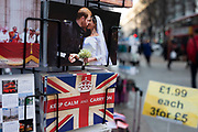Harry and Meghan postcards for sale next to a Union Jack flag card with the slogan Keep Calm And Carry On as if they are kissing goodbye to the UK on a rack on 21st January 2020 in London, England, United Kingdom. Earlier it had been reported that after recent controversy and discussion amongst members of the royal family, that Prince Harry had flown out of the UK to be with his wife Meghan and their family. Prince Harry and Markle announced recently that they will step back from their roles as senior royals to share their time between the UK and Canada, and to continue both their charity work and continue to a degree their royal responsibilities.