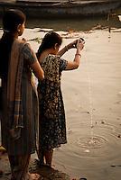 Two pilgrims on the ghats during the festival of Kartik Poornima in Varanasi, Uttar Pradesh, India