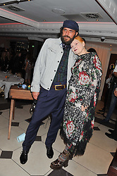 ANDREAS KRONTHALER and DAME VIVIENNE WESTWOOD at a dinner hosted by Dame Vivienne Westwood after her fashion show at London Fashion Week 2012 SS 2013 held at Embassy Restaurant, Old Burlington Street, London on 16th September 2012.