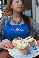 Hannah Vigers who works in the Cuckoo's bakery holding a plate full of cupcakes.<br /> Cupcakes referendum photocall to take place. Cuckoo's bakery has been selling Yes, No and undecided cupcakes since March .<br /> Pako Mera/Universal News And Sport (Europe) 17/09/2014