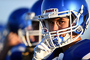 A Garretson Blue Dragons player watches the game from the sidelines Friday night, August 23, 2019, in Garretson.