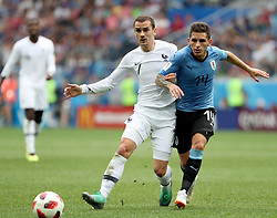 NIZHNY NOVGOROD, July 6, 2018  Lucas Torreira (R) of Uruguay vies with Antoine Griezmann of France during the 2018 FIFA World Cup quarter-final match between Uruguay and France in Nizhny Novgorod, Russia, July 6, 2018. (Credit Image: © Ye Pingfan/Xinhua via ZUMA Wire)