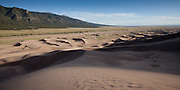 Panorama of the dune field looking south at the Sangre de Cristo Mountains, Great Sand Dunes National Park, Colorado.