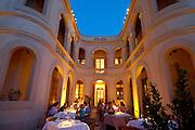 Spanien Spain,Mallorca Balearen..Arta..Hotel San Salvador, Restaurant im Innenhof bei Daemmerung..Hotel San Salvador restaurant in courtyard at dusk....